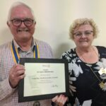 District 9500 Governor Jane Owens presents certificate to President Mervyn to mark the 50th Birthday of The Largs Bay Rotary Club